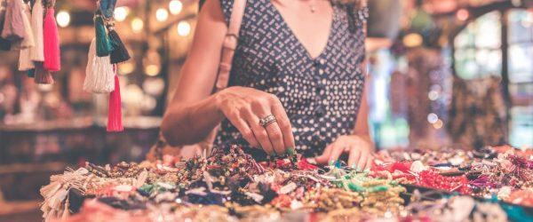 쇼핑 삼매경에 빠진 여성, woman standing beside table of accessories, Image - Artem Bali Featured